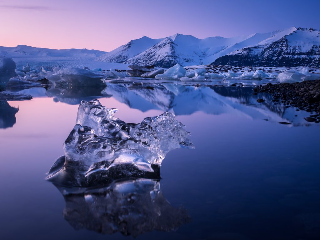 Lone Iceberg floating in the glacier lagoon Jökulsárlón. Located in Iceland